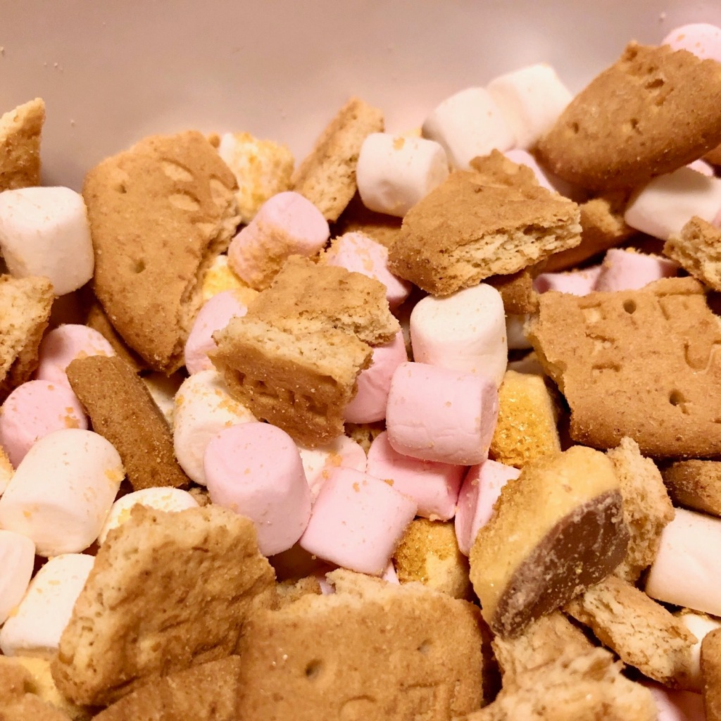 Pieces of digestive biscuit and mini marshmallows awaiting their chocolatey coating