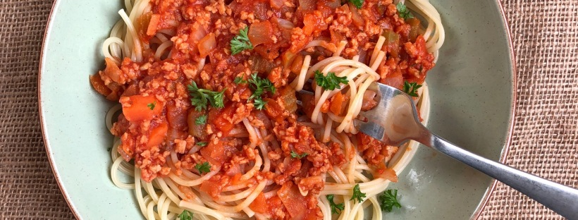 vegan bolognese and spaghetti noodles. the bolognese is made with organic soya mince